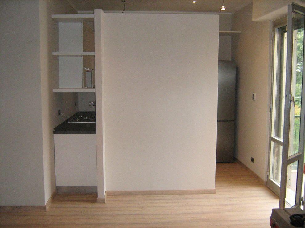 Trilogy La Quinta for a Modern Spaces with a Open Space Living Room and Open Space: La Quinta Divide E Unisce by Idea D' Interni Arredamenti