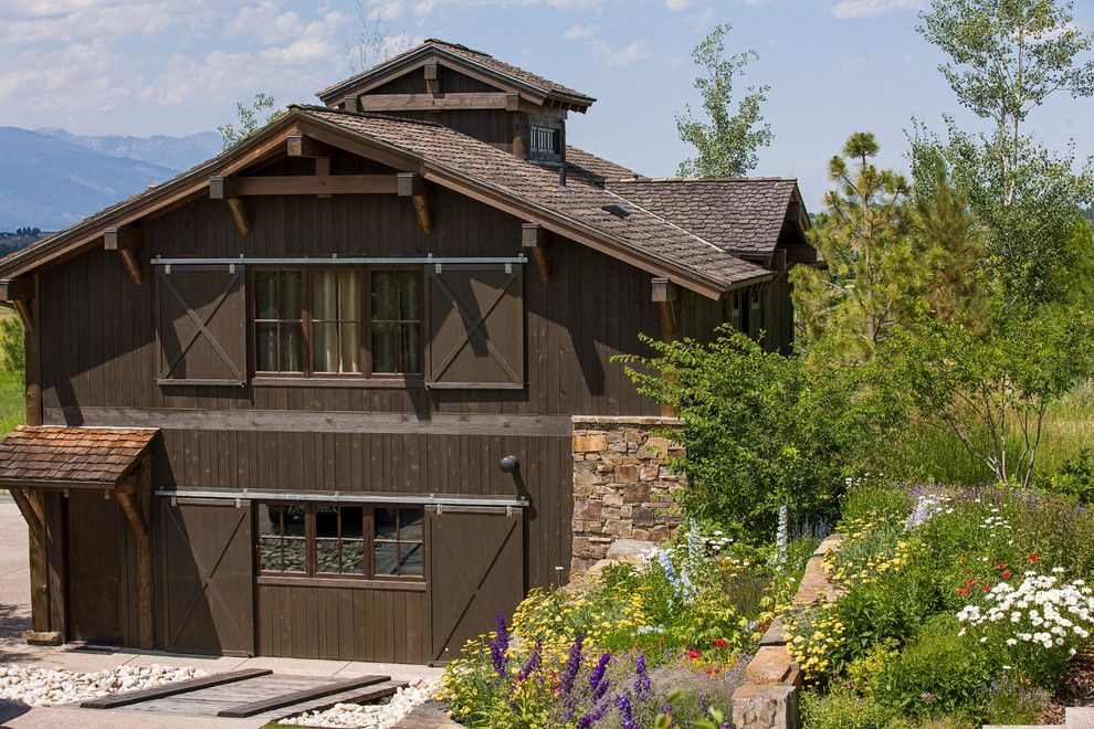 Trimountain for a Rustic Exterior with a Truss and Rocky Mountain Homes  Mountain Timberframe by Rocky Mountain Homes