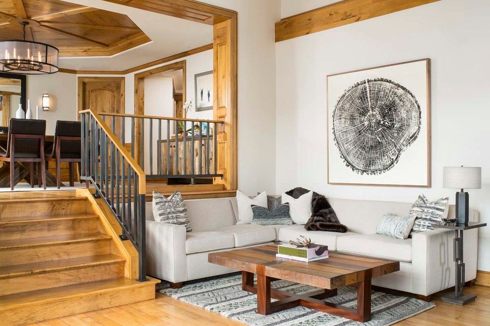 Trimountain for a Rustic Family Room with a Stair Railing and Chateau Beaver Creek, Private Residence by Lkw Design Associates