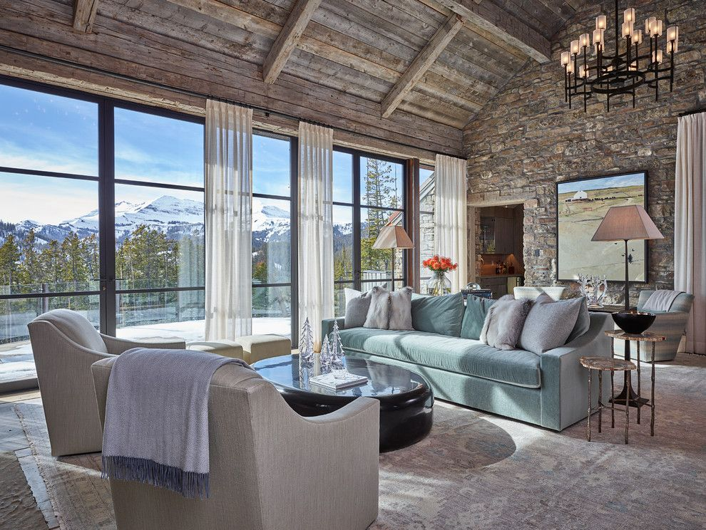 Trimountain for a Rustic Living Room with a Blue Sofa and Lone Mountain Hideaway by Wrj Design