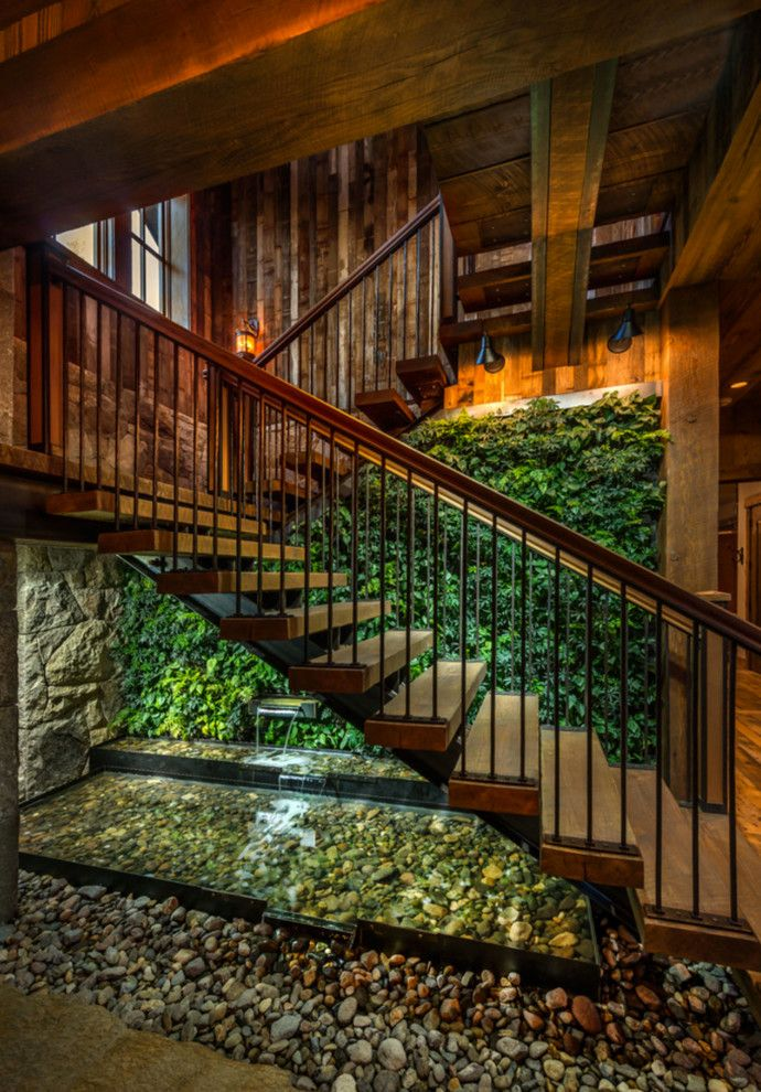 Truckee Meadows Water for a Rustic Staircase with a Stone Wall and Sustainable Mountain Home by Heller Construction, Inc.