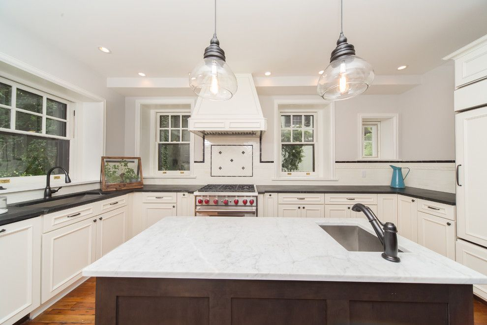 Tudor Oaks for a Traditional Kitchen with a Heart Pine Flooring and Complete Restoration of a 110 Year Old Tudor Style Home by Red Oak Builders, LLC