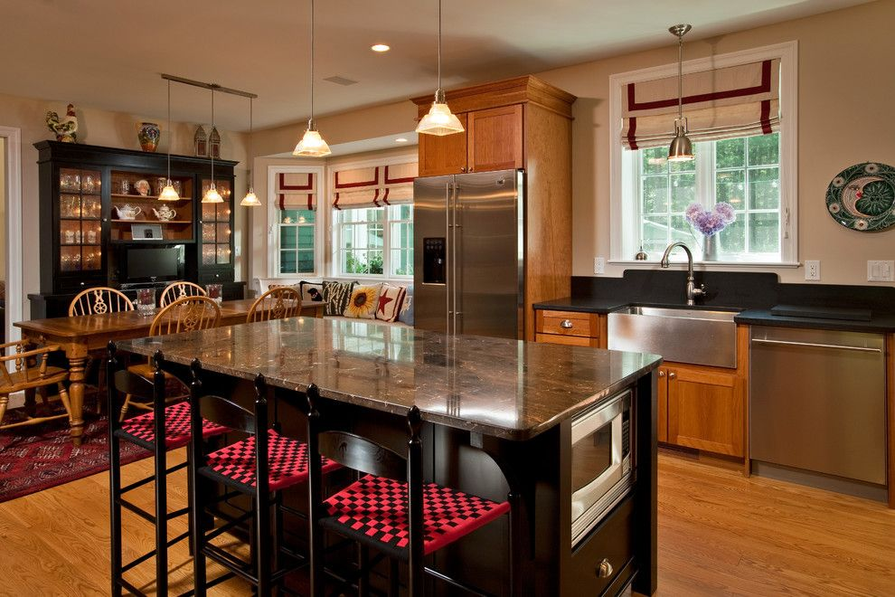 Tudor Oaks for a Traditional Kitchen with a Kitchen Island and Redesigned Reprieve by Teakwood Builders, Inc.