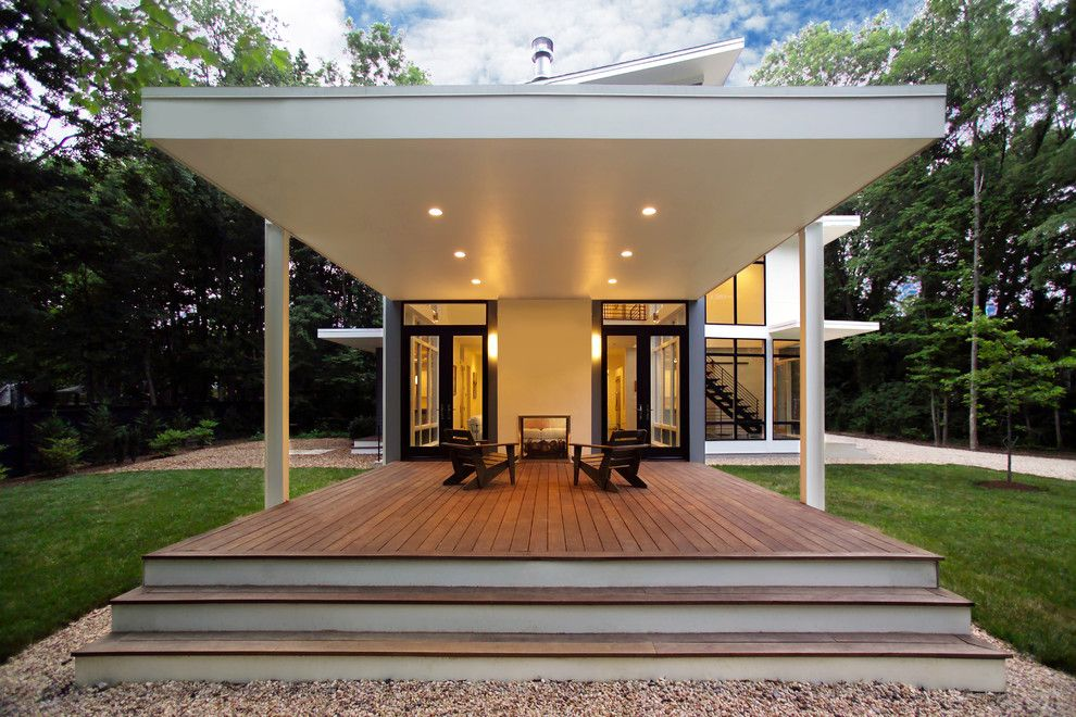 Turf Masters for a Contemporary Porch with a Cantilever and Riverside Residence by Moore Architects, Pc