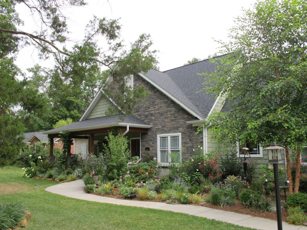 Turf Masters for a Craftsman Exterior with a Rock Wall and Front Porch Makeover Summer 2010 by Anna Looper