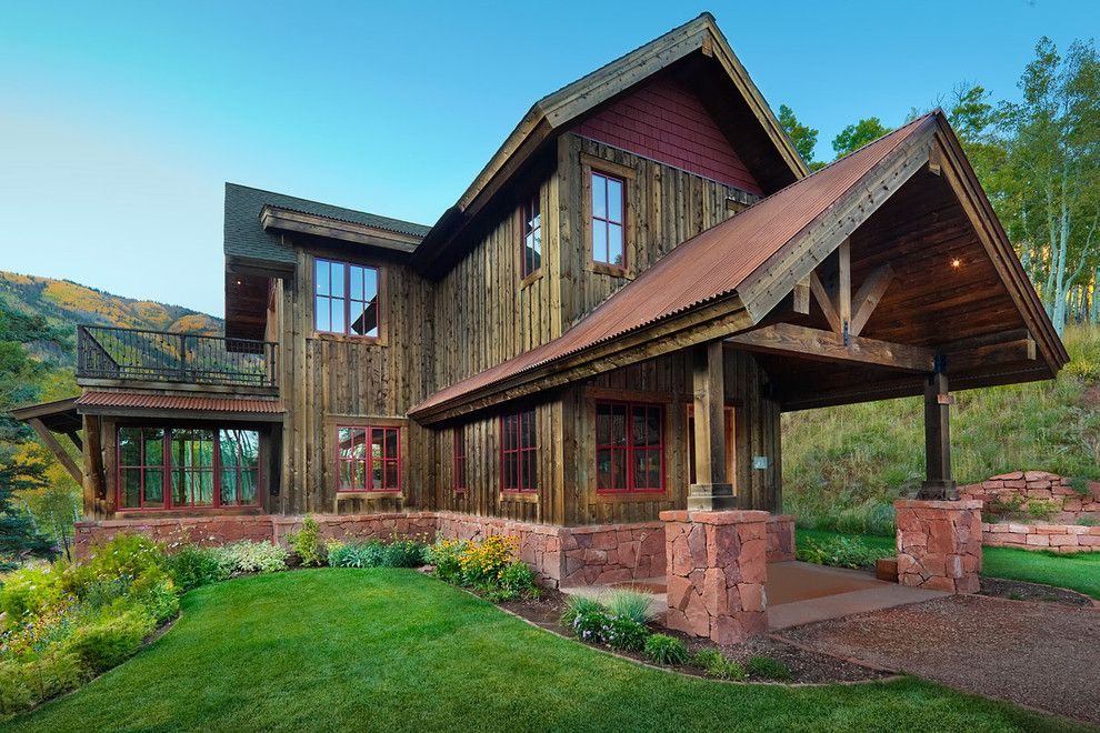 Turf Masters for a Rustic Exterior with a Cabin and Reudi Retreat by Axis Productions