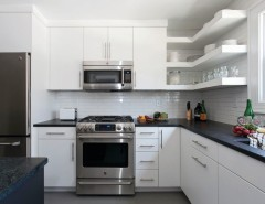 Ultratec for a Contemporary Kitchen with a Granite Countertops and Contemporary and Clean Kitchen in White by UltraCraft Cabinetry
