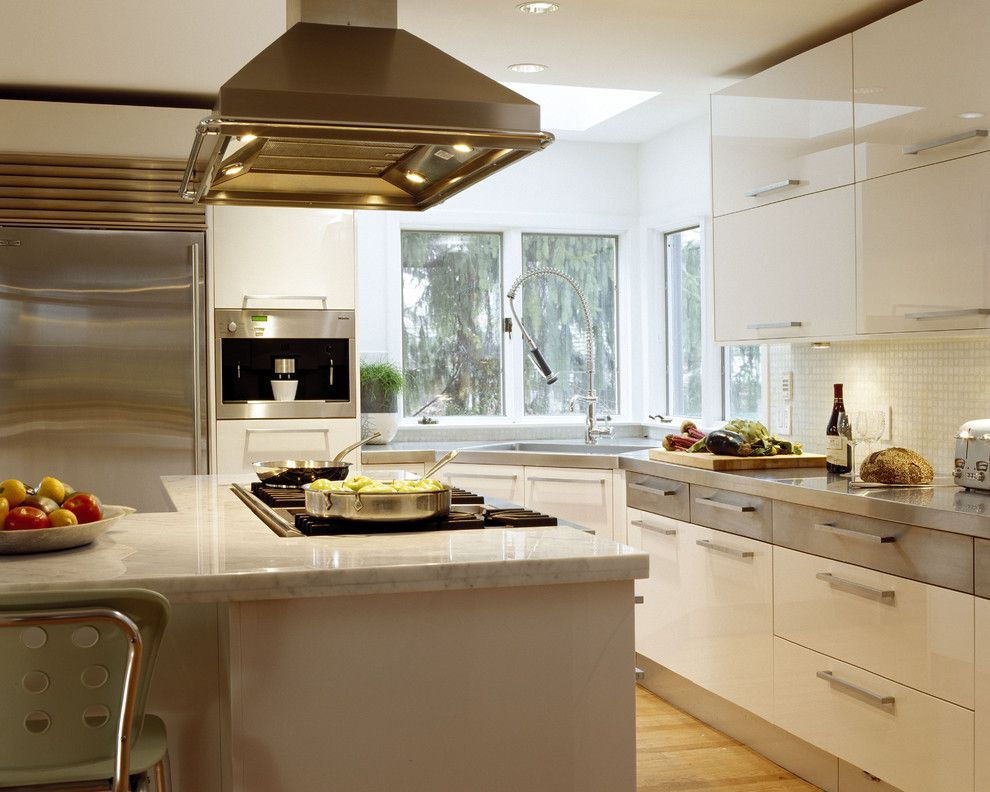 Unclog Kitchen Sink for a Contemporary Kitchen with a Tile Backsplash and Winchester Kitchen by Venegas and Company
