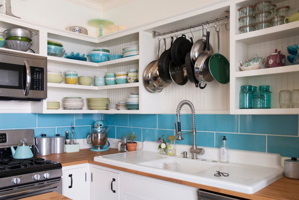 Unclog Kitchen Sink for a Eclectic Kitchen with a Hanging Pot Rack and Chelsea + Kiel: Columbus, Ohio by Adrienne Derosa