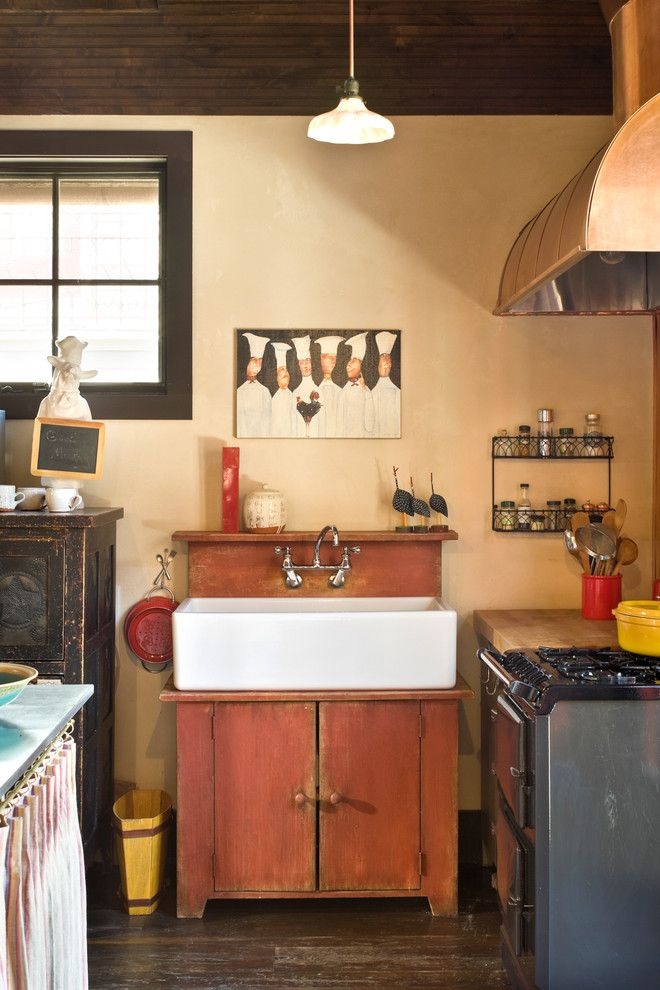 Unclog Kitchen Sink for a Rustic Kitchen with a Farmhouse Sink and Rocky Mountain Retreat by Bob Greenspan Photography