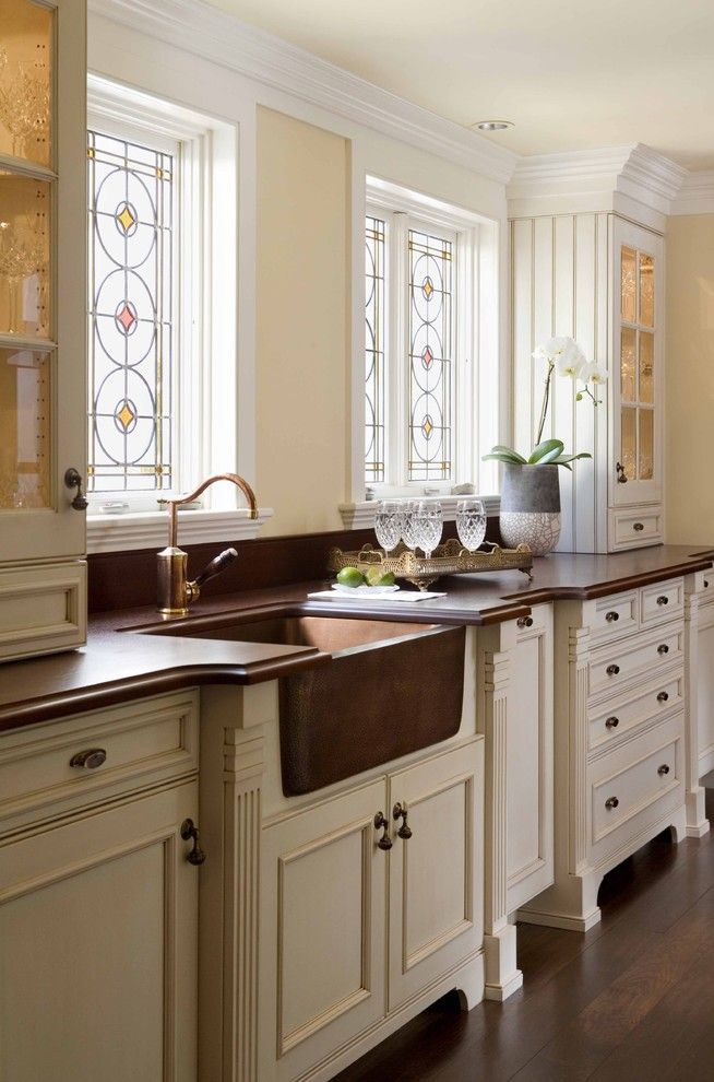 Unclogging a Sink for a Traditional Kitchen with a Oil Rubbed Bronze and Chestnut Street Kitchen by Venegas and Company