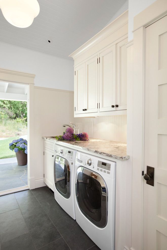 Unclogging a Sink for a Traditional Laundry Room with a Sloped Ceiling and Waterfront Estate by Jodi Foster Design + Planning