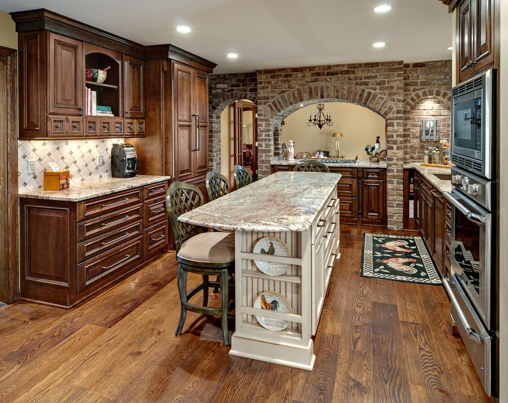 Uncommon Goods.com for a Rustic Kitchen with a Wide Plank Oak Floors and Scotia Remodel by Knight Construction Design Inc.