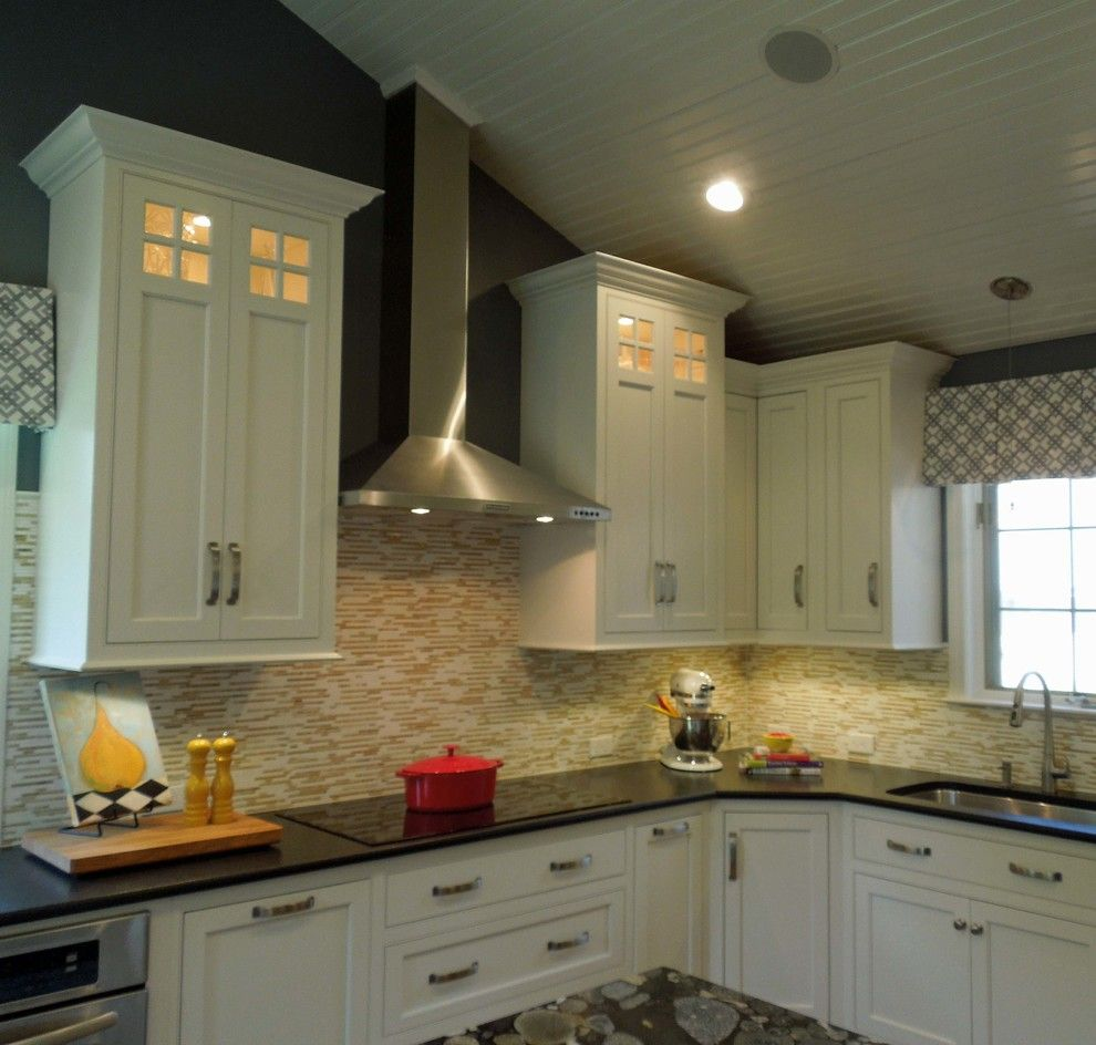 Undermain Theatre for a Traditional Kitchen with a Marble and Sloped Ceiling with Chimney Hood by Delicious Kitchens & Interiors, LLC