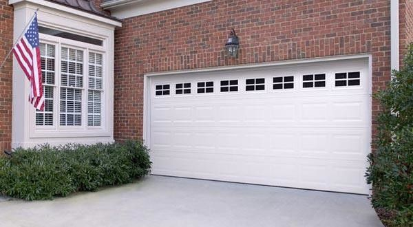 Valley Forge Flag for a Traditional Garage with a Brick and Raised Panel by Empire Overhead Doors, Llc