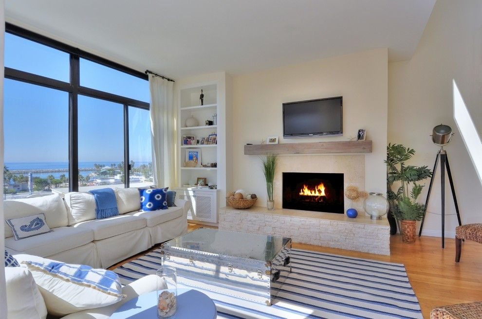 Valley View Theater for a Beach Style Living Room with a Silver Trunk Coffee Table and Redondo Beach Project by Zd Interiors