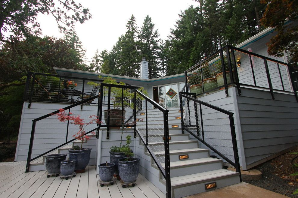 Velvet Rope Portland for a Modern Spaces with a Cable Railing System and Modern Aluminum Deck by G. Christianson Construction, Inc.