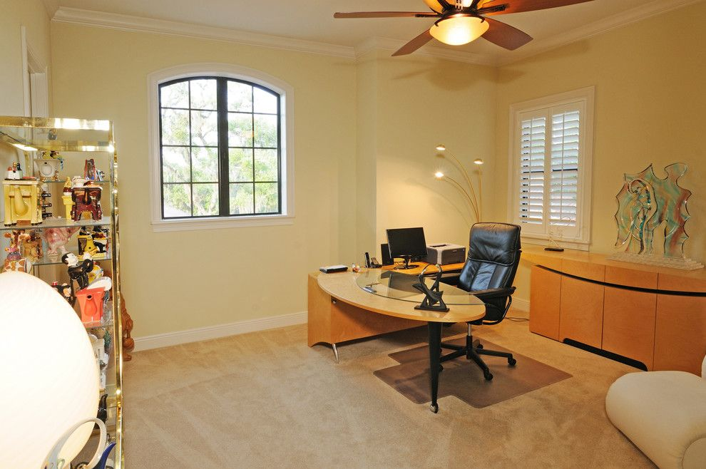 Venetian Theater for a Mediterranean Home Office with a Dark Wood and Henin Signature Homes Valentina by Henin Homes