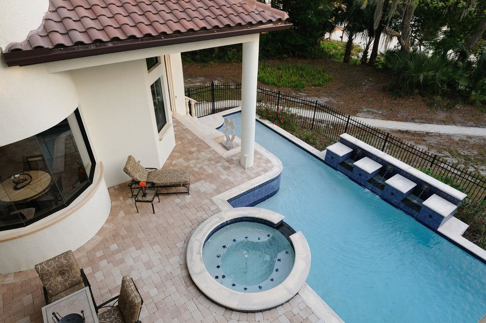 Venetian Theater for a Mediterranean Pool with a Garden Tub and Henin Signature Homes-Valentina by Henin Homes