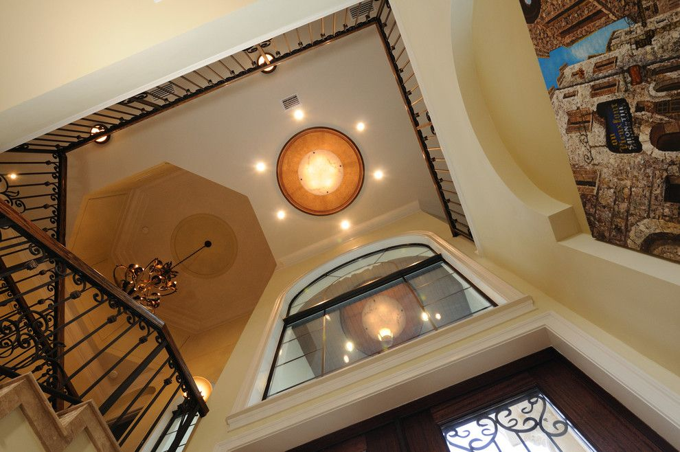 Venetian Theater for a Mediterranean Staircase with a Iron Staircase and Henin Signature Homes Valentina by Henin Homes
