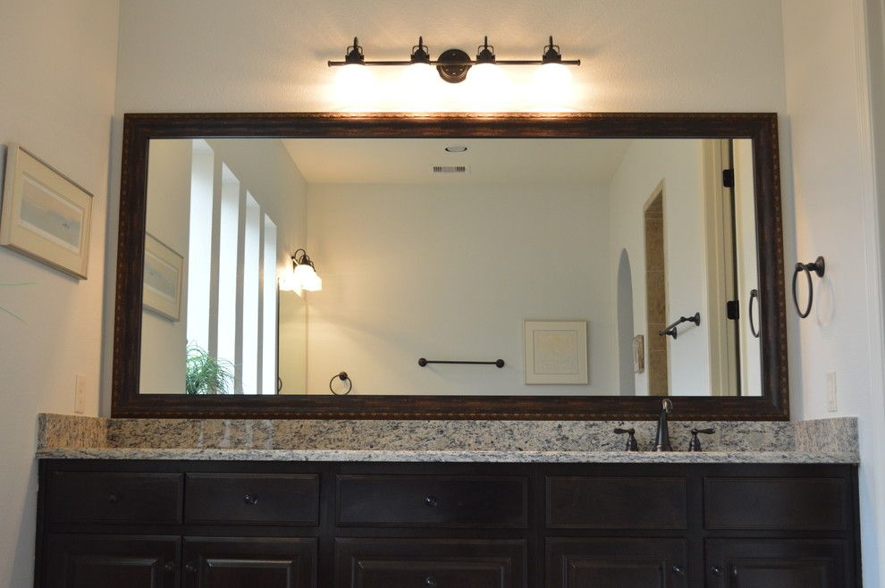 Veritas Houston for a Contemporary Bathroom with a Custom Mirror Moulding and Before and After Photos by Mirrorcle Frames Houston