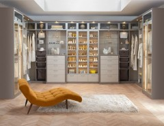 Victors Lighting for a Contemporary Bedroom with a Glass Front Cabinets and Fashionista Walk- in Closet by California Closets HQ