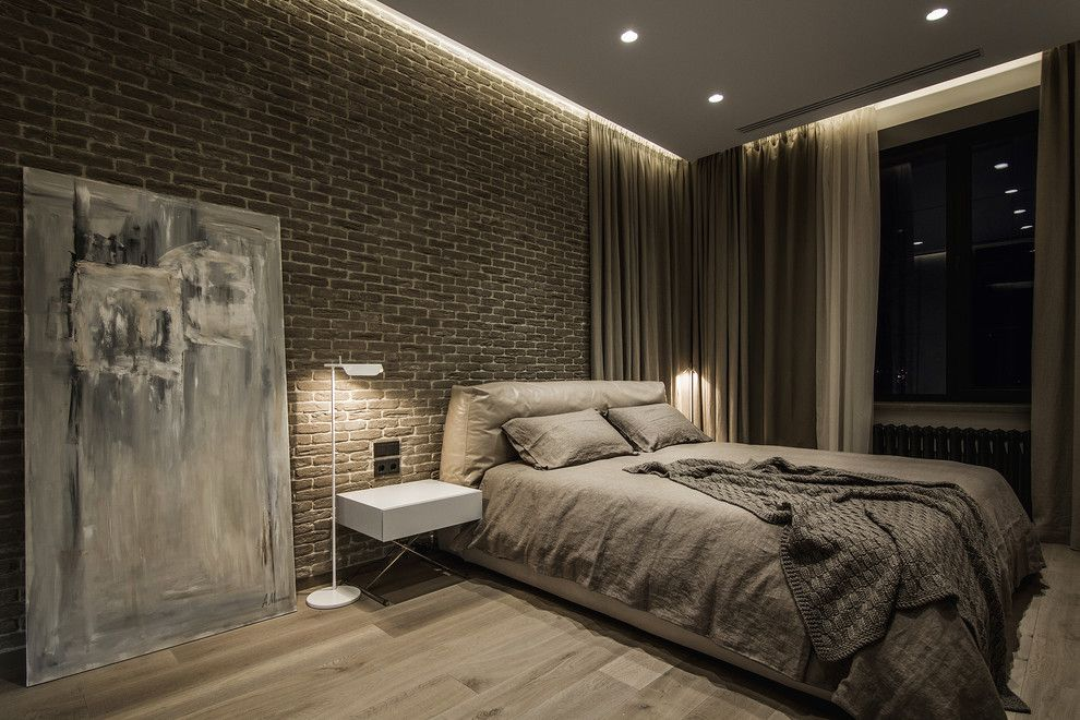Victors Lighting for a Contemporary Bedroom with a Side Table and Apartment Artist by YØdezeen