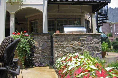 Viking Fence for a Craftsman Exterior with a Tennessee Field Stone and Tiller Residence- Eagle Point, Woodstock (Atlanta, Ga) by Michael Boyd Construction