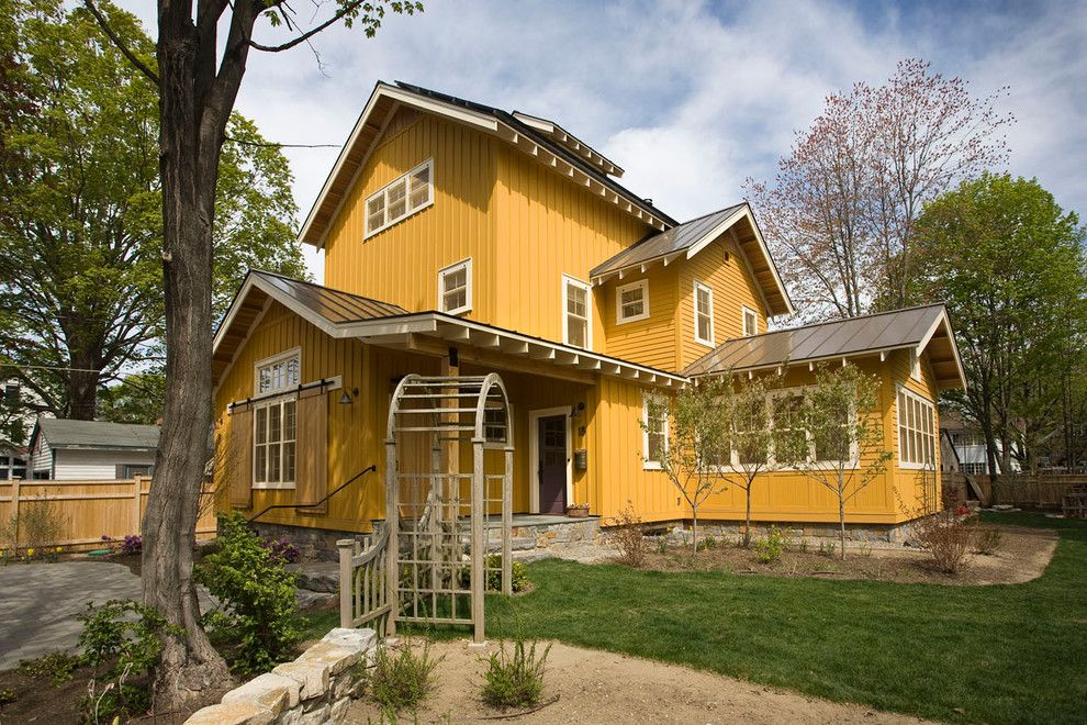 Viking Fence for a Farmhouse Exterior with a Yellow Siding and Custom Homes by Phinney Design Group
