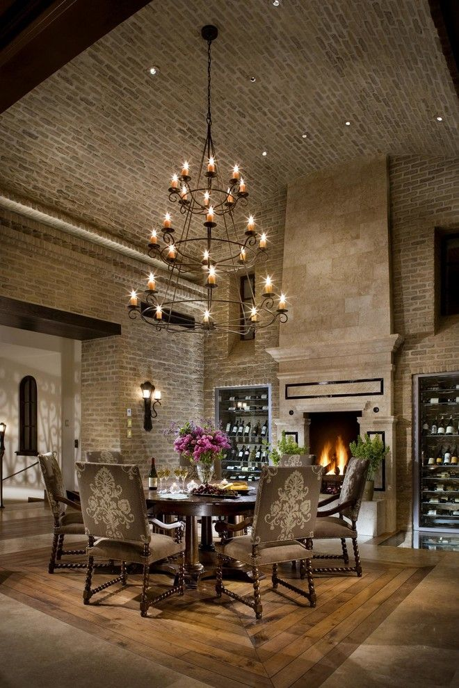 Vistal Golf for a Mediterranean Dining Room with a Wine Cellar and Old World Brick Dining Room by Eldorado Stone