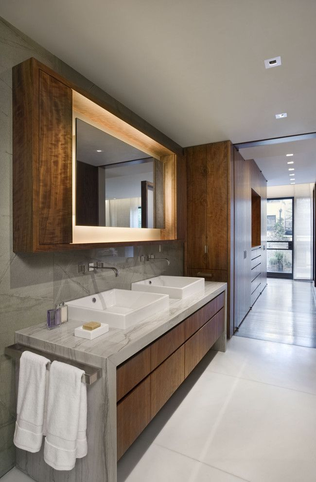 Vitreous China for a Contemporary Bathroom with a Custom Wood Cabinets and West Village Townhouse by David Howell Design