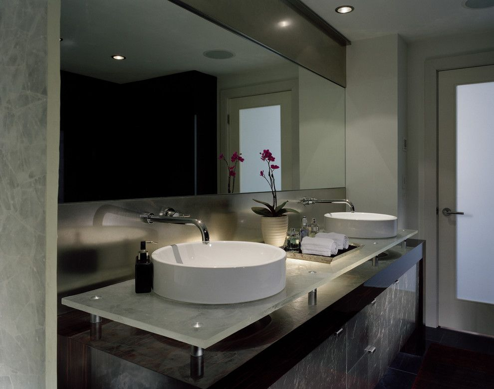 Vitreous China for a Contemporary Bathroom with a Glass Doors and Master Bath by Garret Cord Werner Architects & Interior Designers