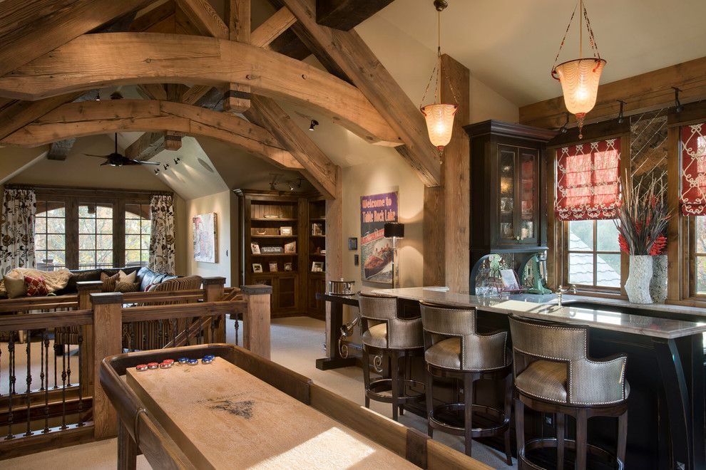 Wade Jurney Homes for a Rustic Family Room with a Lighting and Chimney Rock Residence by Locati Architects