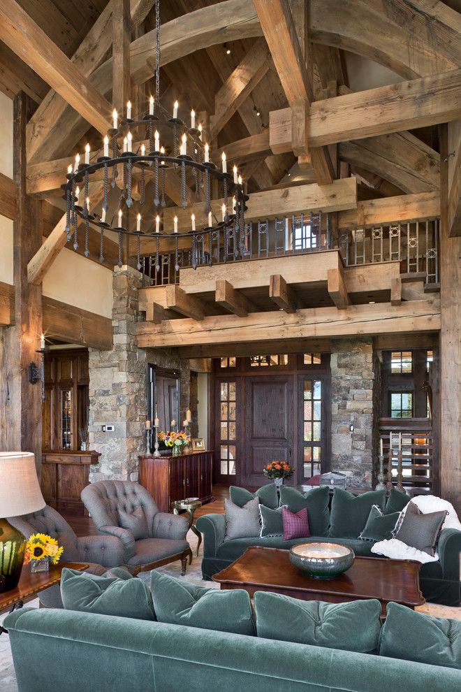 Wade Jurney Homes for a Rustic Living Room with a Timber Trusses and Yellowstone Club Summit Residence by Locati Architects