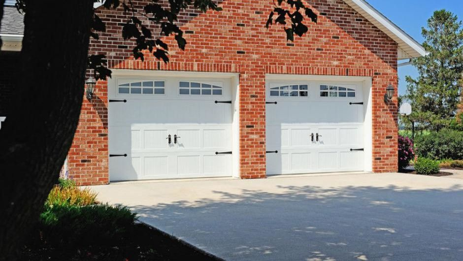 Wade Jurney Homes for a Traditional Garage with a Garage Doors and Stamped Carriage House by Empire Overhead Doors, Llc