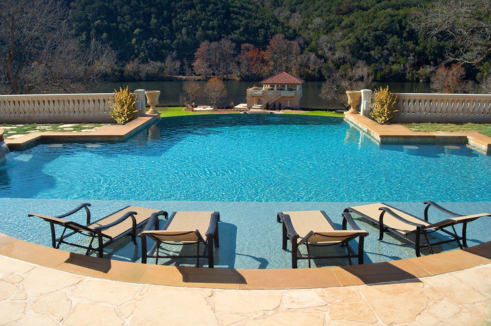 Wade Jurney Homes for a Traditional Pool with a Stone Railing and Luxury Backyards by Cody Pools, Inc.