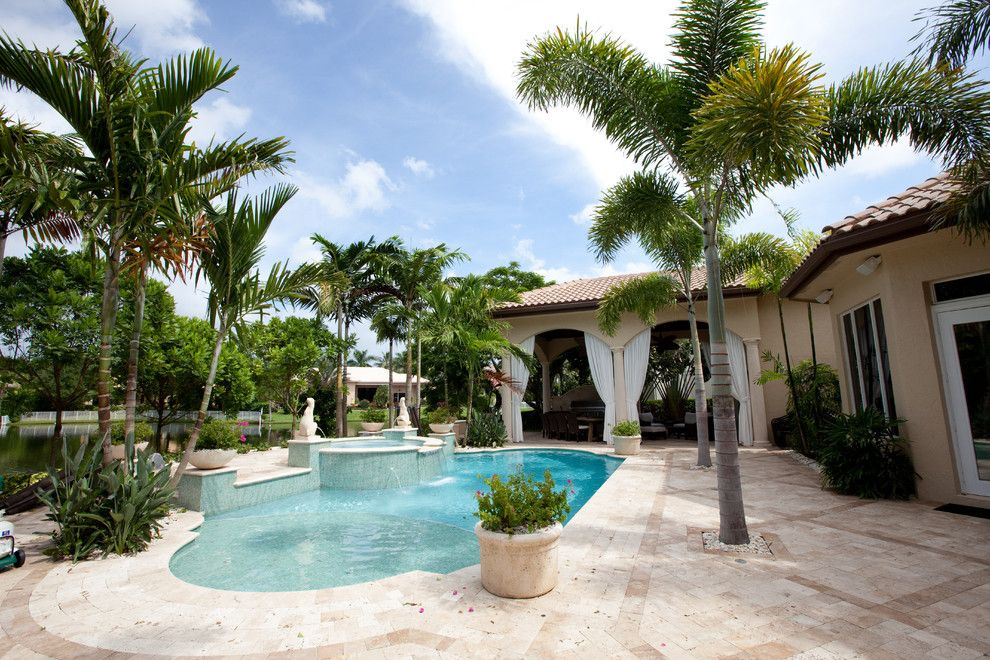 Wade Jurney Homes for a Tropical Pool with a Tile Tub Deck and Hawks Landing by Complete Home Improvement Group Inc.