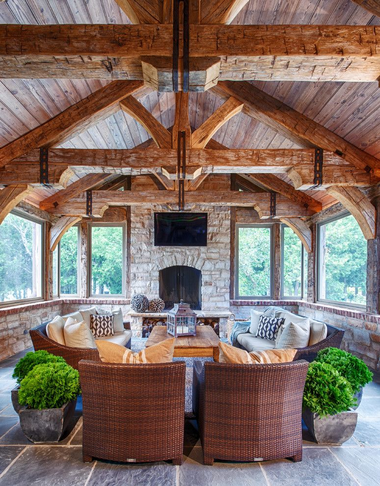 Waller Rustic Furniture for a Rustic Family Room with a Sloped Ceilings and Rustic Elegance by Deleers Construction, Inc.