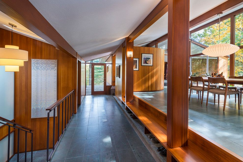 Walter Gropius for a Midcentury Dining Room with a Floor to Ceiling Glass and Sculpted to the Land by Flavin Architects