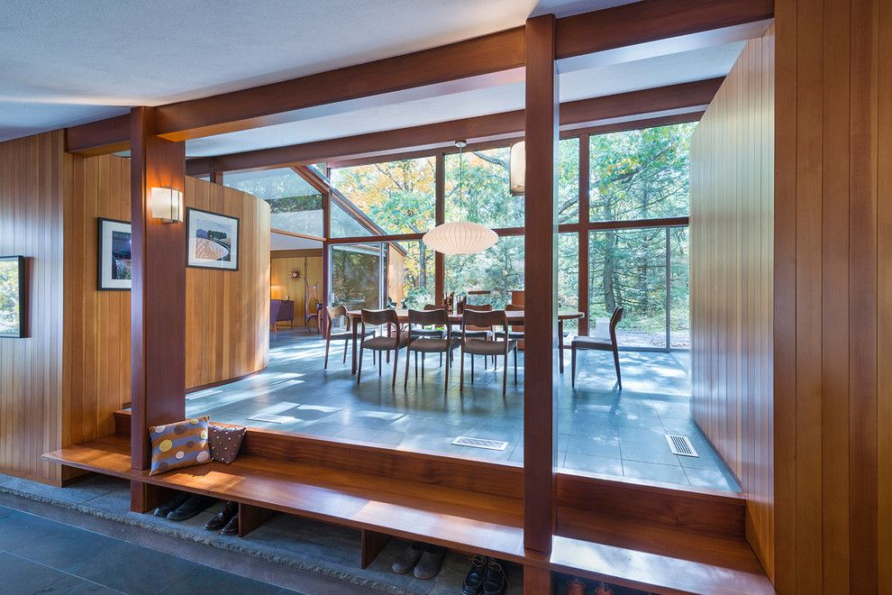 Walter Gropius for a Midcentury Dining Room with a Gable Room and Sculpted to the Land by Flavin Architects