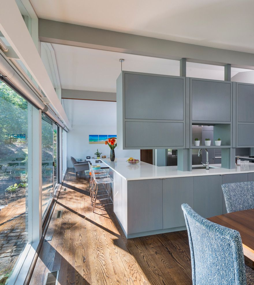 Walter Gropius for a Midcentury Dining Room with a White Counter Top and Mid Century Remodel on Tabor Hill by Flavin Architects