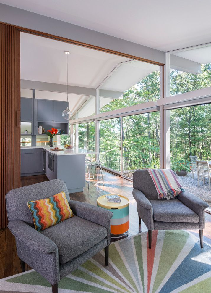 Walter Gropius for a Midcentury Living Room with a Custom Cabinets and Mid Century Remodel on Tabor Hill by Flavin Architects