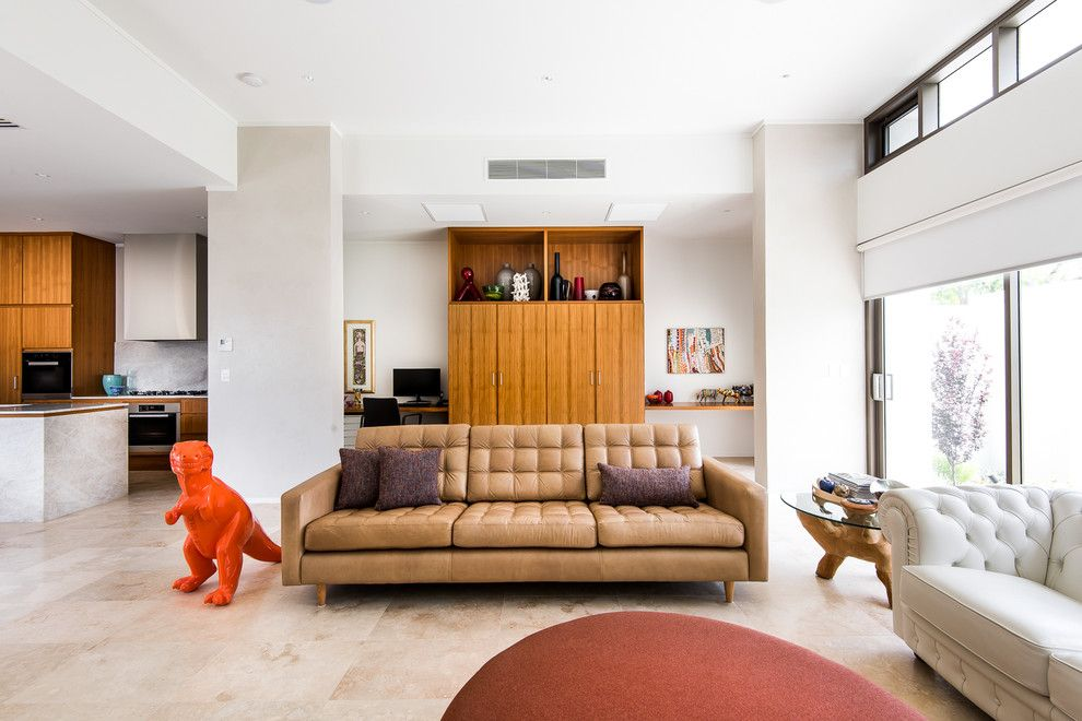 Walter Knoll for a Midcentury Living Room with a Stone Tiles and House a by Sandy Anghie Design