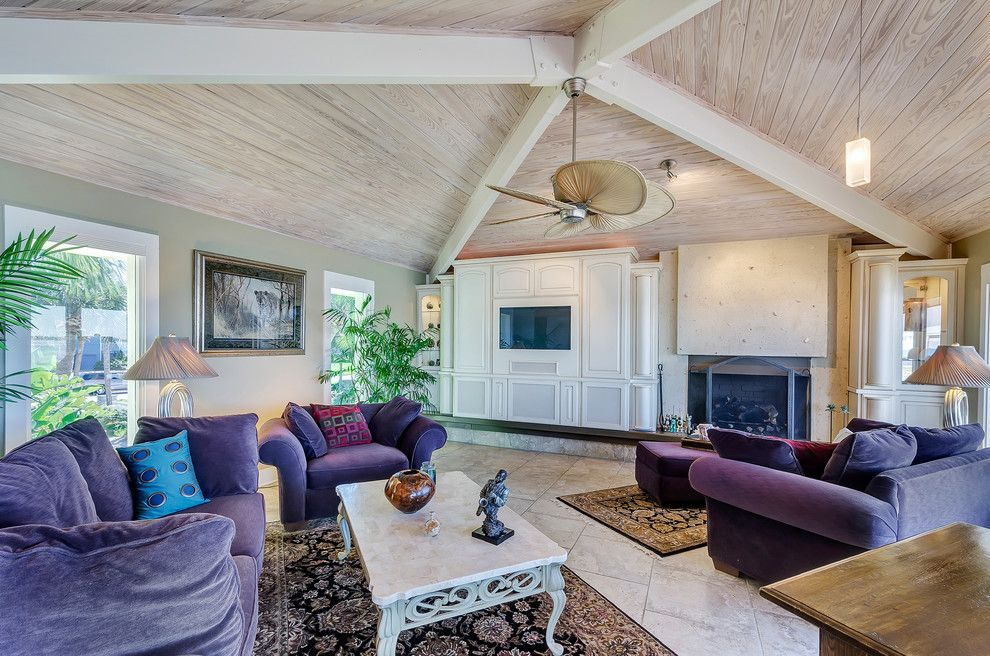 Wardley Real Estate for a Tropical Living Room with a Column and 259 Sabine Pensacola Beach, Fl by Emerald Coast Real Estate Photography