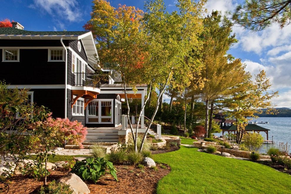 Warm Season Grasses for a Traditional Landscape with a Exterior and Brauner Residence by Phinney Design Group