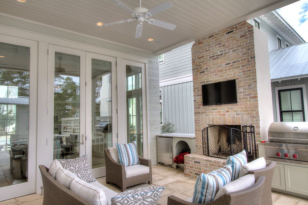Watercolor Fl for a Beach Style Patio with a Brick Fireplace and 22 Flatwood St, Watercolor, FL by Borges Brooks Builders