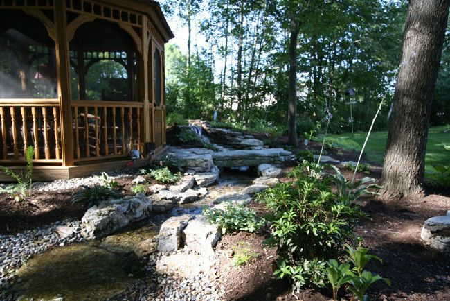 Waterscapes for a Traditional Landscape with a Backyard Garden Ideas and Waterscape Projects by Perennial Landscaping