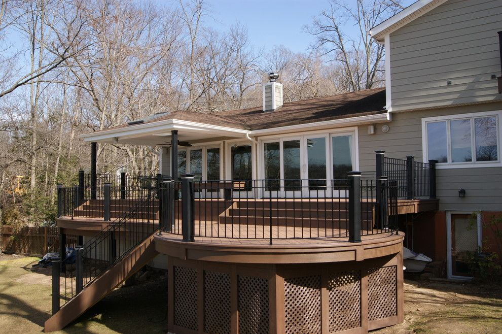 Weichert Nj for a Traditional Deck with a Round Deck and Piano Deck    Round Azek Deck with with Custom Rails a View by Deck Remodelers.com