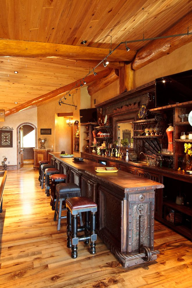 Westec for a Rustic Home Bar with a Arched Doorway and Awesome Log Cabin by Passion Lighting