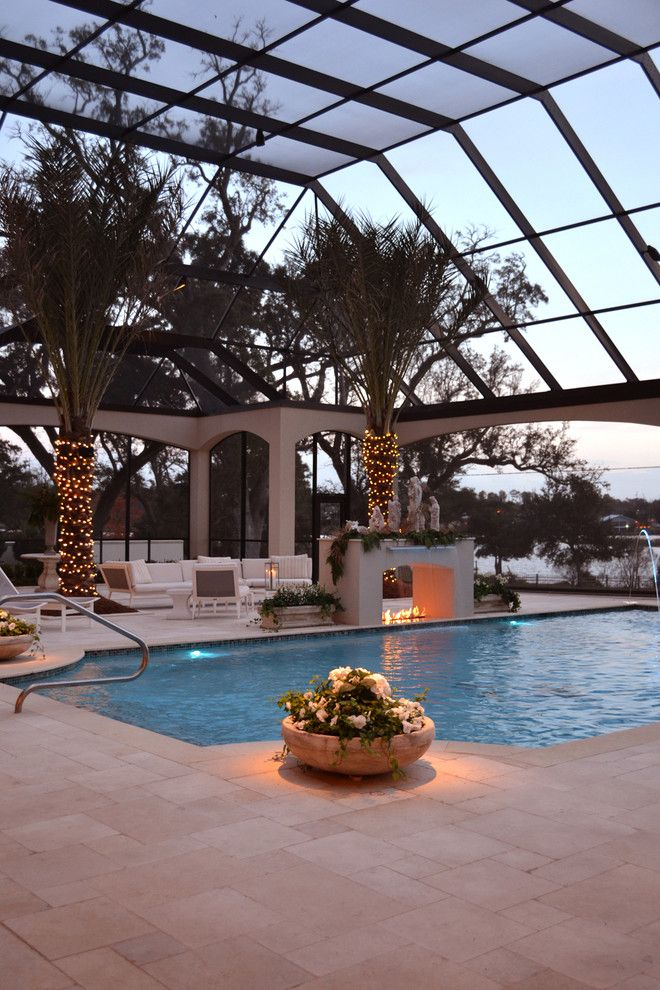 What is a Chiver for a Mediterranean Pool with a Beige Stone Patio and Private Residence in Gulfport, Ms by Rj Elder Design